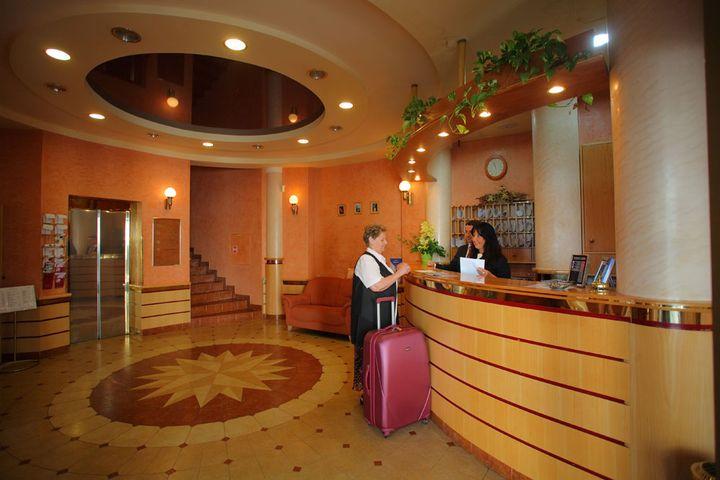 Поселение в гостиницу
